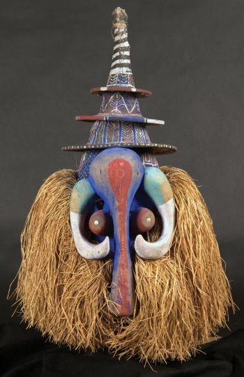 Yaka artist (Democratic Republic of the Congo); Tsekedii mask, 20th century; wood with cloth, pigment, and raffia. University Art Museum, CSU, gift of John A. and Mary Pat Carlen, 2008.