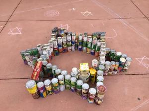 Members of Hillel, the Jewish fraternity on campus, made a star of David with their cans. The event is part of the annual Cans Around the Oval food drive for the Larimer Food Bank.