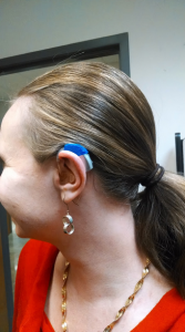 Megan Aanstoos tests out her 3D printed hearing aid cover