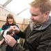 CSU veterinarian evaluates Tess the penguin as her handler holds her