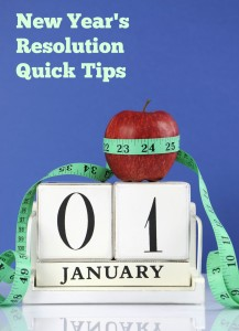 Happy New Year healthy slimming weight loss or good health resolution with red apple and measuring tape on white wood vintage style calendar for January first. Vertical with copy space.