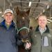Drs. Patrick McCue and Ryan Ferris pose with a dark brown horse