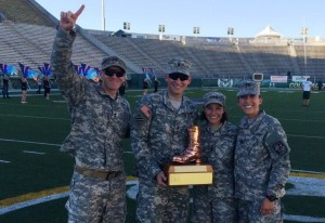 Caitlin Lozano and cadets holding the Bronze Boot at Hughes Stadium