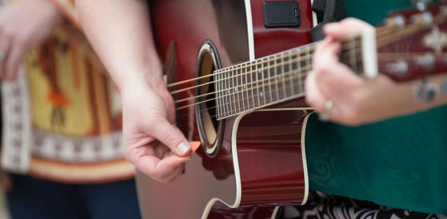 Picture of hands playing guitar.