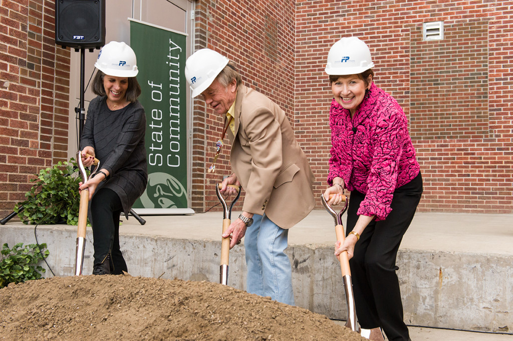 From left, Linny Frickman, Torleif Tandstad and Dorothy Horrell dig in at the groiundbreaking.