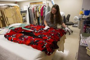 Avenir graduate assistant Caitlin MacLaughlin works on a Richard Blackwell garment.