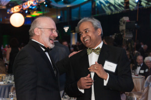 Menon speaks with former College of Business Associate Dean John Olienyk at the 1870 Dinner marking the completion of the $500 Million Campaign for CSU on Feb. 4, 2012.