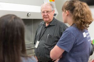 Ellis speaks with students in the mock BSL-3 lab on the Foothills Campus.