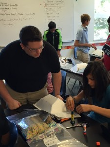 Engineering and teacher licensure student John Avery teaches a solar oven design activity which he modified to emphasize mathematical energy gain calculations.