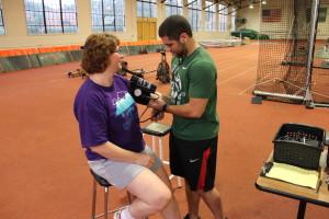 Malone checks Pecora's blood pressure.