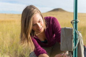 Colorado State University ecology PhD student checks a wildlife camera in the City of Fort Collins Soapstone Prairie Natural Area, September 22, 2015, in the area where a herd of purebred American bison will be released in the fall of 2015.