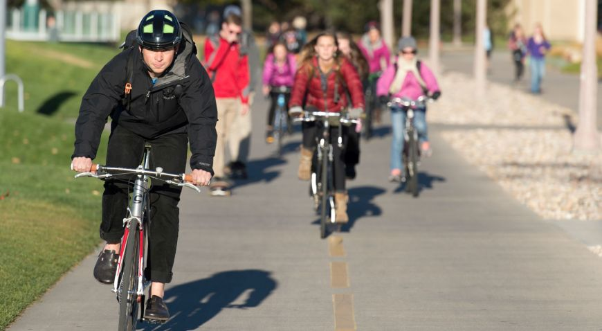 Colorado State University students, employees and guests ride bicycles on a campus bike path, Nov. 4.