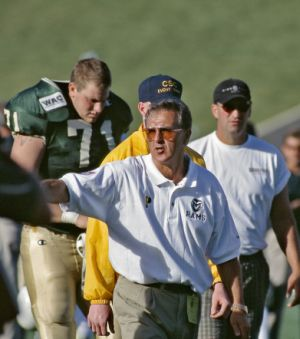 Colorado State University Head Football Coach Sonny Lubick coaches at football game at Hughes Stadium during a game against UNLV, 1997.
