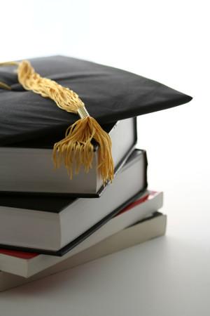 Graduation cap and textbooks