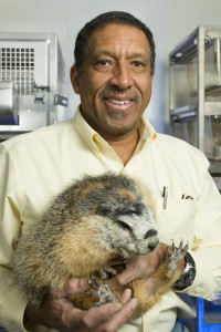 "Gregory Florant, Professor of Biology, with ""Baby"" the marmot. January 25, 2012"