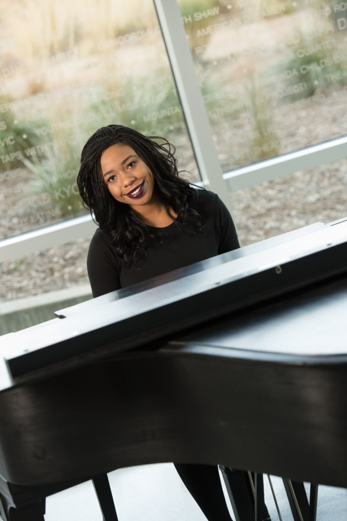 Jada Boyd, Junior Biomedical Sciences major, plays the piano in the Lory Student Center Theatre lobby. December 9, 2015