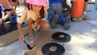 "A participant of the summer 2015 Kids Do It All Program in Todos Santos takes time to create her DJ table prop for ""El Disco Real."""