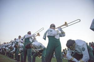 The trombone section performs No. 5 at the Homecoming and Family Weekend pep rally