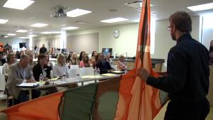 Student Ben Gerding discusses a kite design.