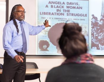 Colorado State University Ethnic Studies assistant professor Ray Black gives a guest lecture on women artists of the civil rights movement in the 1960s in a Women in Art class, March 25, 2016.