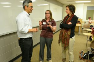 Ishiwata, left, speaks with Fort Morgan High School teachers Denise Gondrez and Taylor Jordan.