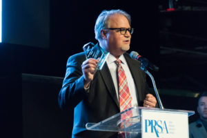 Milligan accepts the award for Colorado PR Team of the Year.