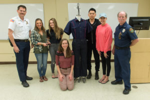 Team Marvel is presented with First Place for their redesign of Firefighter uniforms as part of an AM 376 Class project. May 11, 2016