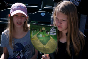 girls with Baseball Science on a Stick