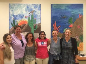 Kim Kita (second from left) with colleagues Amy Rex, Aines Castro, Tania Zenteno-Savin, McKenzie Campbell, and Danielle Straatmann (left to right) at a community event in May, 2016. The artwork was created by CSU Fish, Wildlife and Conservation Biology students and local grade school students.