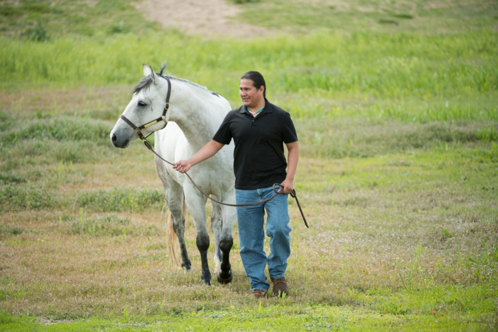"Patrick Succo, a second year DVM student, with ""Blue"" a CSU horse at CSU's Equine Center. May 27, 2016"