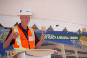 Doug Johnson, Vice President, Adolfson and Peterson Construction, delivers remarks at the Topping-Out Ceremony for Colorado State University's Health and Medical Center. August 1, 2016