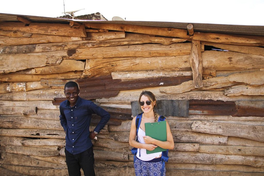 Alyse Daunis stands next to the GSSE group's driver, Hashim Mutanje, in a village near Jinja, Uganda. Alyse worked with Hashim at the start-up social enterprise LiTeAfrica when she lived in Uganda for a year.
