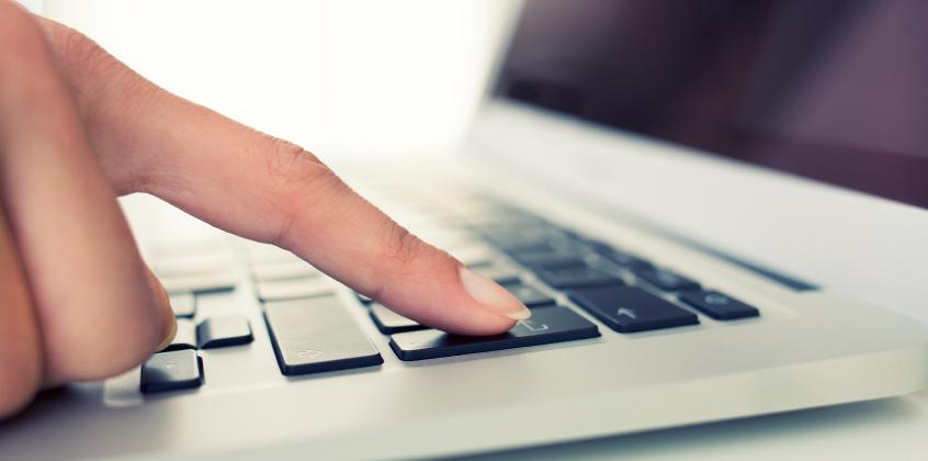 woman laptop finger indoor desk