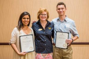 Colorado State University chapter President Liz Hicks, left, and University of Montana chapter Vice President Matthew Thomas, right, received a Mortar Board Gold Torch from section coordinator Kelsey Willis.
