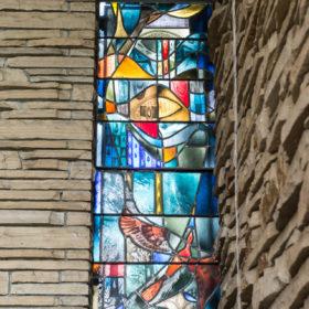 Vandalized Danforth window restored, installed
