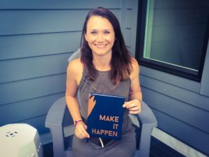 College of Business graduate Chelsea Williams with her company's planner.