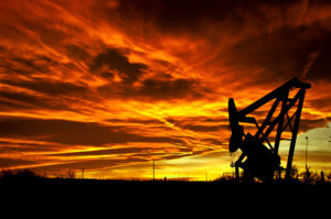 A pump jack at sunset. Image by Justin Vidamo.
