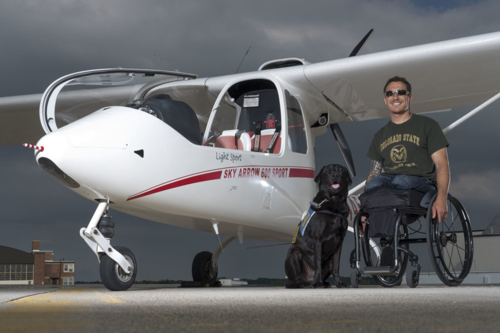 Bernard Dime earned his pilot's license this summer through Able Flight, a non-profit that helps people with disabilities become pilots. (Photo by AJ Mast)