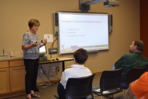Cindy Horner, left, of ECCF Board of Directors makes a presentation at the Northeast Regional Engagement Center.