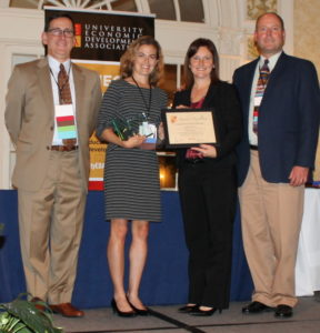 Paula Mills, center left, project manager in the Office of Engagement, accepts the 2016 Award of Excellence for 'Place + Innovation' from University Economic Development Association board members. The award was accepted on behalf of CSU's Energy Institute at the Powerhouse Energy Campus.
