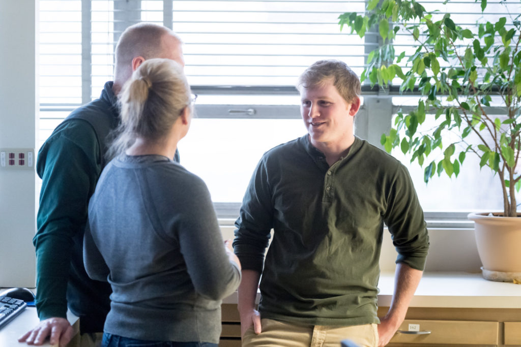 Toxicology Masters student Tim Mowry talks with mentors Associate Professor Marie Legare and Professor William Hanneman, all with Environmental and Radiological Health Sciences, talk about Mowry's upcoming fellowship in Japan. December 6, 2016