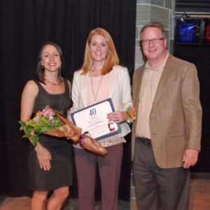 Audra Brickner, center, with 40 Under Forty sponsors Ella Fahrlander of the Community Foundation and Chris Otto of EKSH.