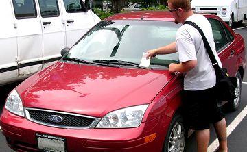Car getting a parking ticket