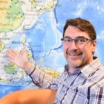 Bob Kling in front of world map