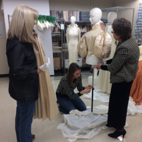 Needle artists restore garments at the Avenir Museum