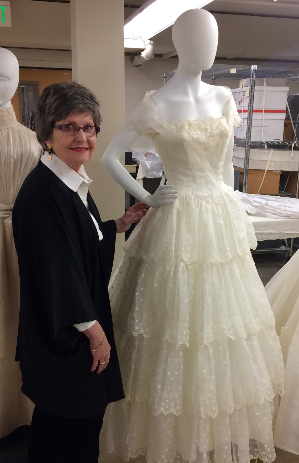 Mary Biggers repairing the 1950s organza wedding dress