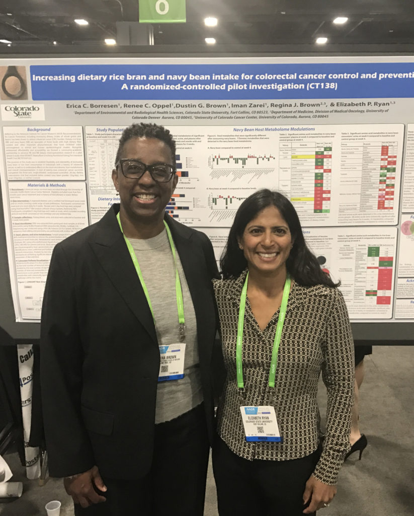 Dr. Regina Brown of UCHealth, left, and CSU researcher Elizabeth Ryan prepare for their poster presentation at the American Association for Cancer Research 2017 meeting in Washington, D.C.