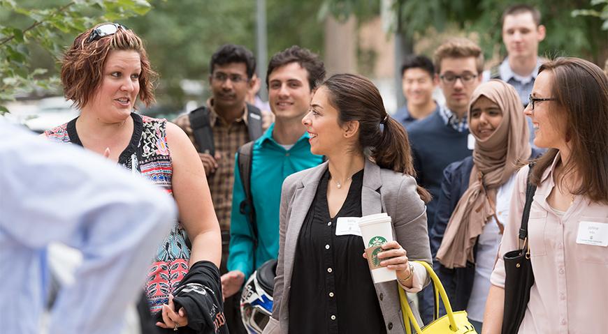 MAB students visit while walking.