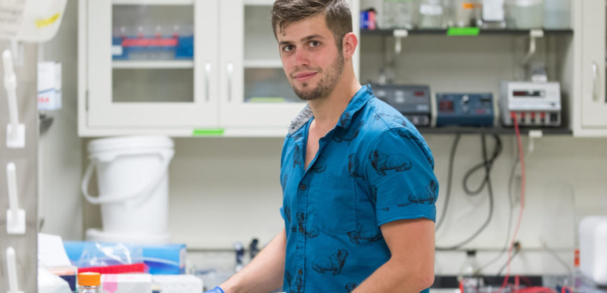Color photo of Joseph Fauver in the Ebel Lab