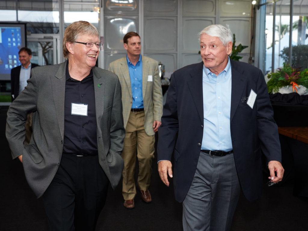 Dr. Wayne McIlwraith, Dr. David Frisbie, and John Malone walking.